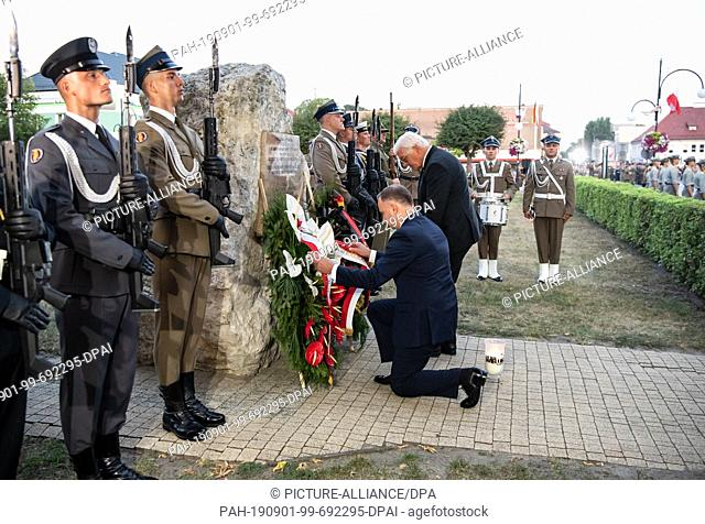 01 September 2019, Poland, Wielun: Federal President Frank-Walter Steinmeier (3rd from right) and Polish President Andrzej Duda lay a wreath at the Memorial to...