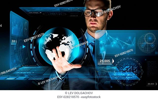 business, people, future technology, mass media and cyberspace concept - close up of businessman touching earth globe projection on virtual screen over dark...
