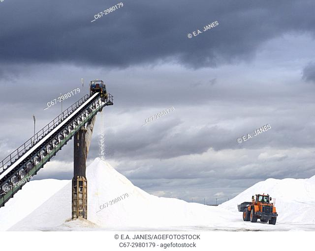Salt being processed and broken down by machinary in Spain