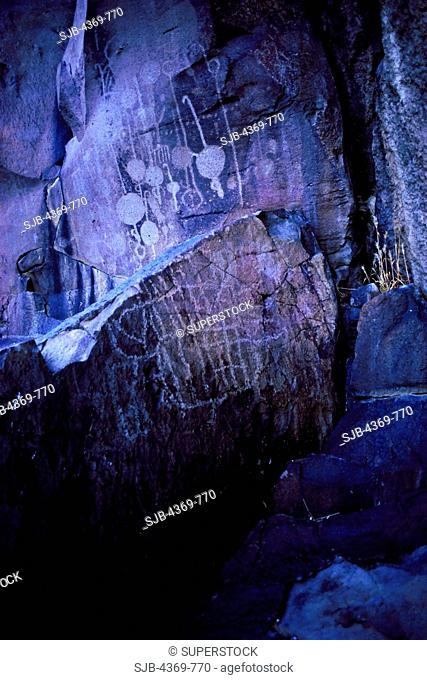 Atlatl petroglyphs in at Site Iny-8c R-25, Upper Renegade Canyon of the Coso Mountains of California. Atlatl glyphs celebrate the ancient invention, the atlatl