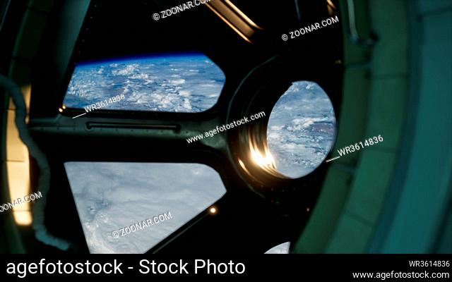 Cockpit view from International Space Station operating nearby of planet Earth. Elements of this image furnished by NASA
