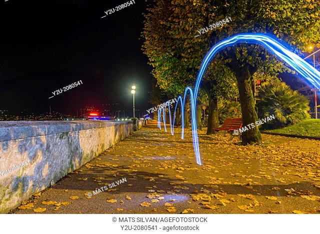 Light trails on the walkway in autumn at night in locarno ticino switzerland
