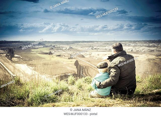 Germany, Saxony, Schleenhain, Father showing brown coal mining to son