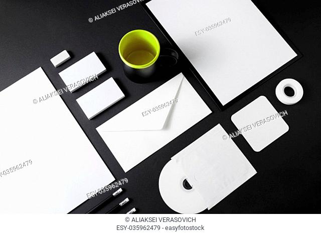 Blank stationery set on black paper background. Corporate ID mockup. Mock up for branding identity. Responsive design template