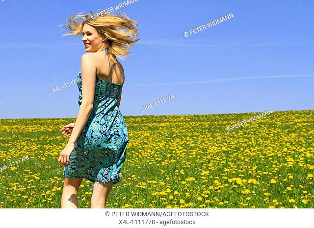 Happy young woman in spring
