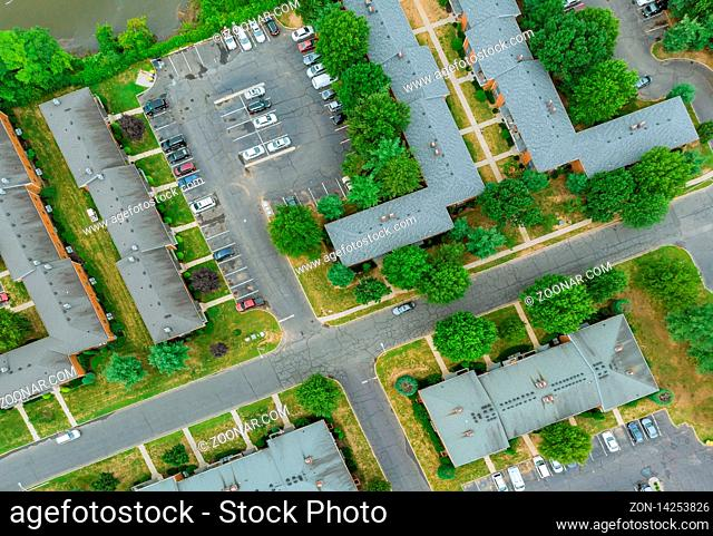 Top view flying over town home showing family houses with of roof top of a residential area