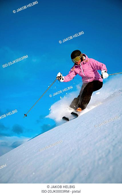 Woman extreme skiing in powder snow