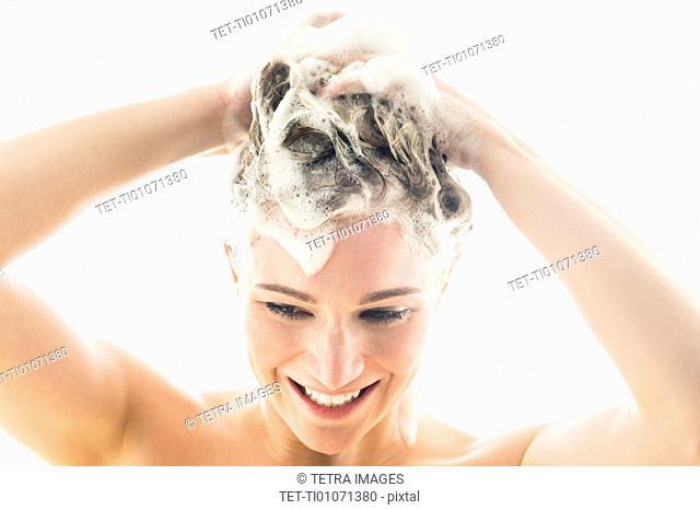 Beautiful woman washing hair