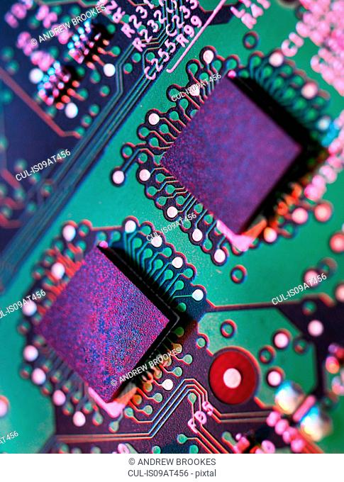 Close up detail of green and purple computer circuit board