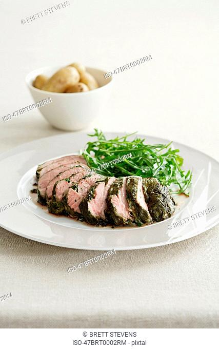 Plate of veal with salad and potatoes