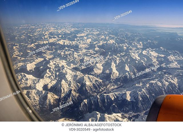 View from a passenger plane, alpine mountain peaks of the Swiss Alps in Switzerland, Europe