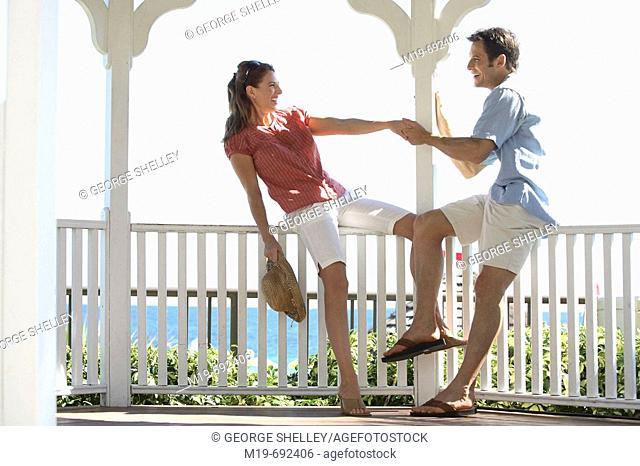 Playful couple dancing in a Gazebo