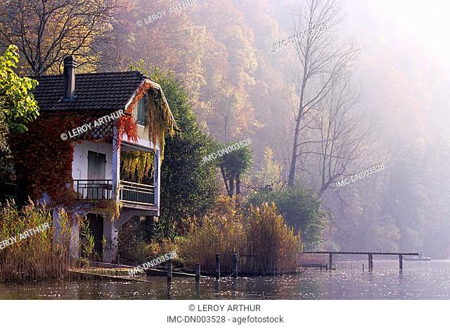 France, Alps, Saint Alban de Montbel, lake of Aiguebelette, house in the mist