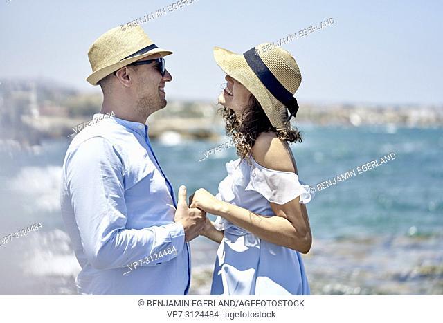 couple enjoying holidays at seaside