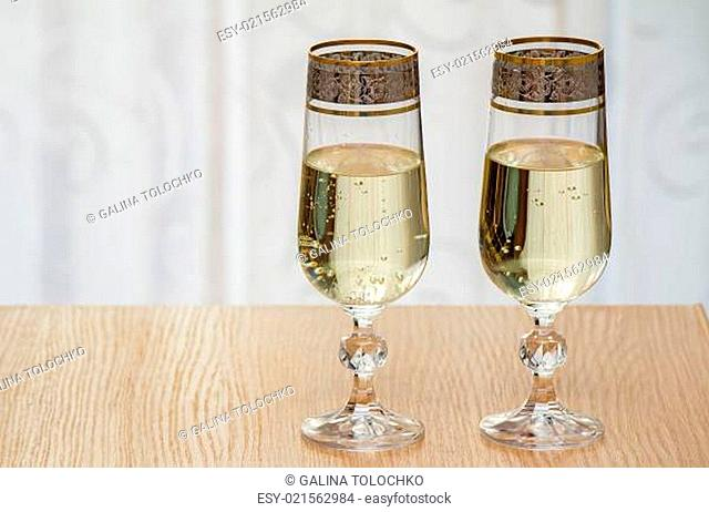 Two champagne flute filled with champagne