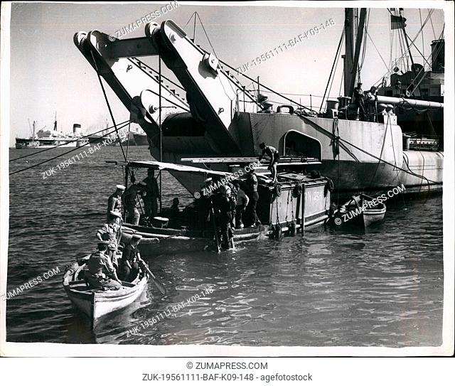 Nov. 11, 1956 - The Middle East Crisis..Naval Drivers at work clearing the canal Block ships: Photo Shows A Navy diver from one of the salvage vessels goes down...