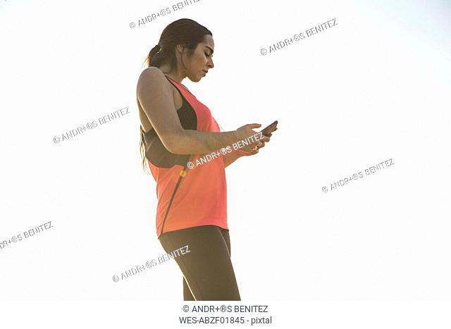 Female athlete using her phone