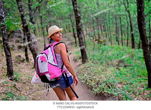 Young woman hiking through Jerte Valley, Caceres, Spain