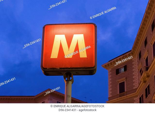 Metro sign at dusk, Naples, Italy