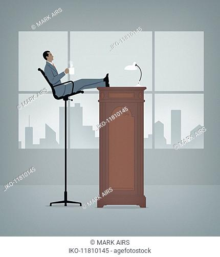 Manager relaxing high up on tall desk and chair