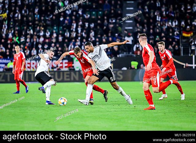 Wolfsburg, Germany, March 20, 2019: footballers Jonathan Tah (GER) and Sergej Milinkovic (SRB) in action during the international soccer game Germany vs Serbia...