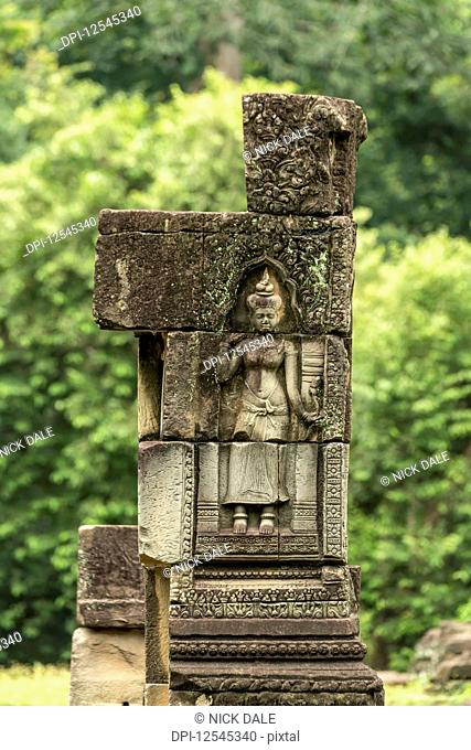 Sculpture of woman in Baphuon temple column, Angkor Wat; Siem Reap, Siem Reap Province, Cambodia