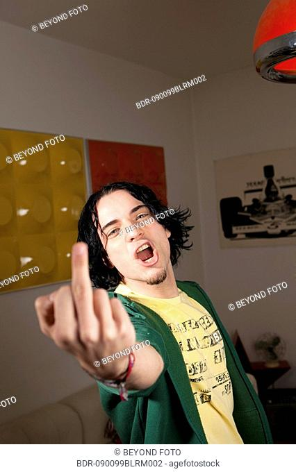 young man showing the middle finger
