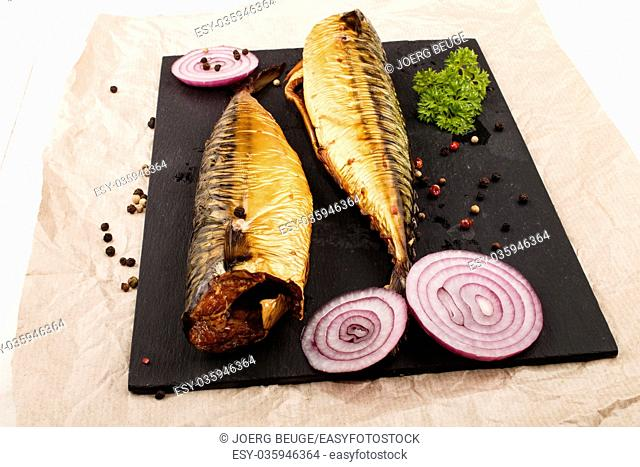 smoked mackerel with parsley, lilac onion and peppercorn on slate