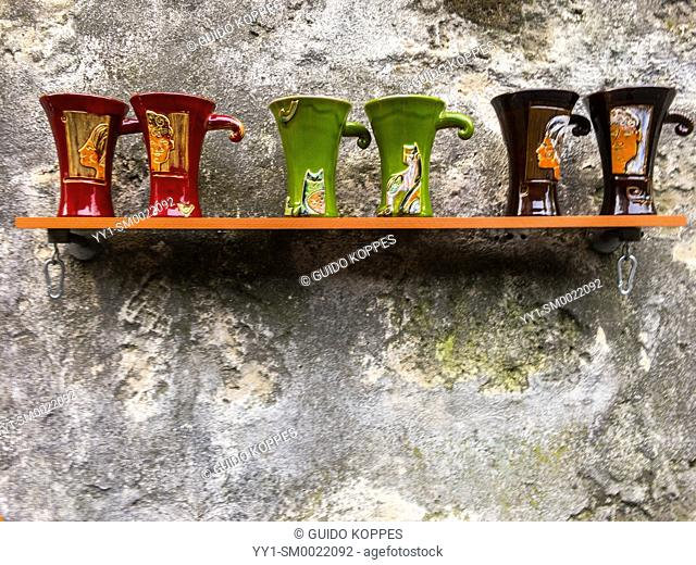 Paris, France. Ceramic Merchandise on Display on a little shelf mounted to a wall in Montmartre. Tourism often boosts local small businesses and enterprises