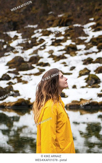 Iceland, smiling woman in Icelandic landscape