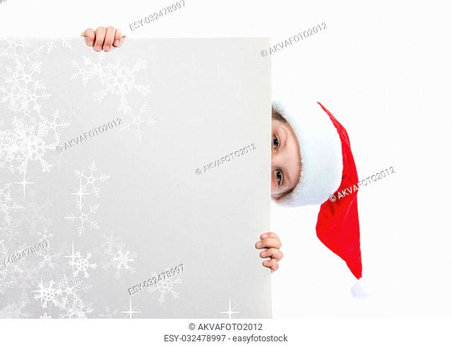 girl in santa claus hat holding a poster