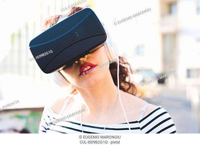 Woman wearing virtual reality and headphones