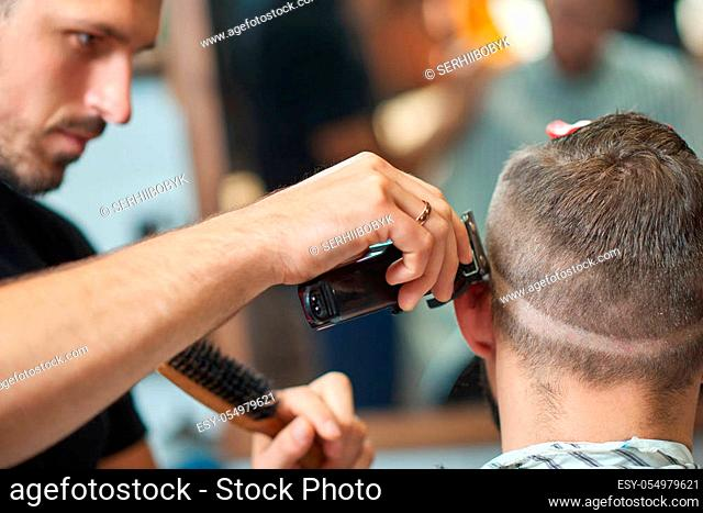 Cropped close up of a professional barber working giving a haircut to a man