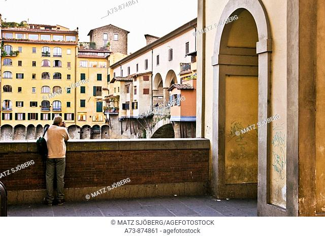 Arcades of the Corridoio Vasariano and Ponte Vecchio, Florence. Tuscany, Italy