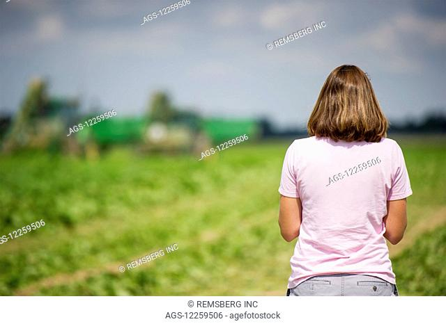 Female farmer looking out at her farmland; Preston, Maryland, United States of America