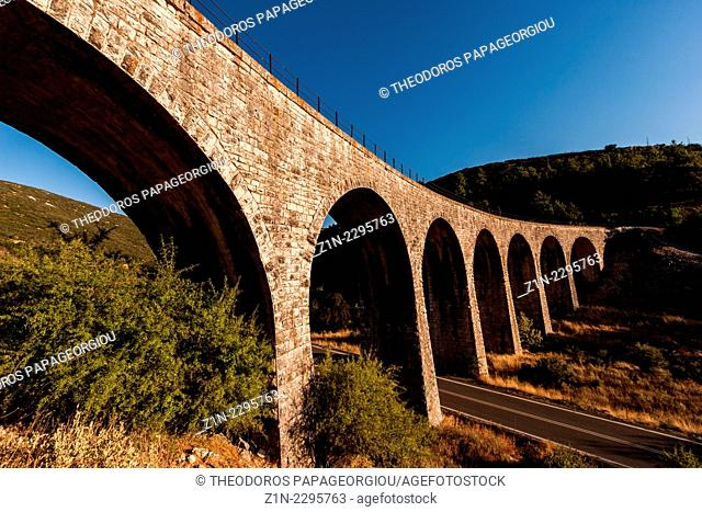 The largest train stone bridge in Greece (110m with 12 arches), designed by the French engineer A. Gotteland and builld by P. Lepeche