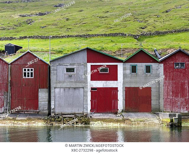 Boat sheds in the harbour of Sorvagur (Soervagur), a small town at Sorvagsfjordur. The island Vagar, part of the Faroe Islands in the North Atlantic