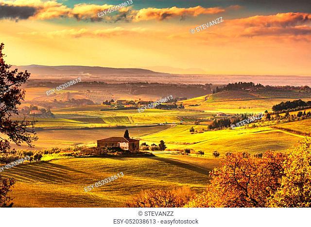 Maremma, rural sunrise landscape. Countryside farm and green fields. Elba island on horizon. Tuscany, Italy, Europe