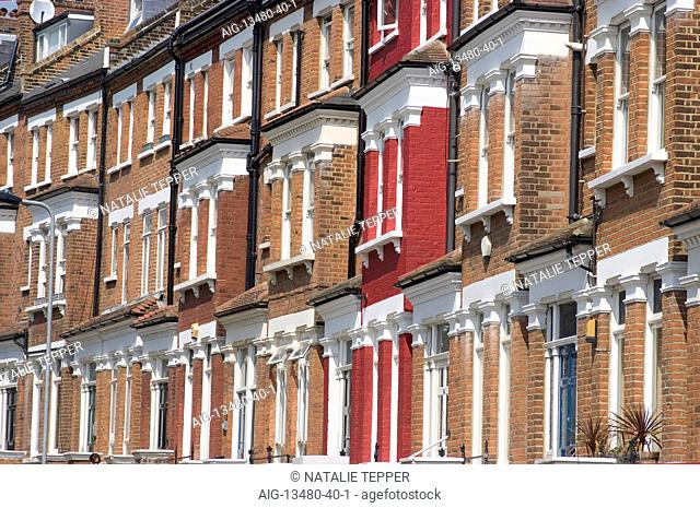 Residential terrace flats, with one red, house, Belsize Park, London, NW1, England