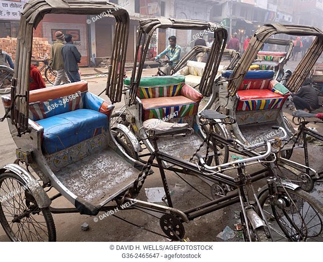 Parked pedicabs and busy street, Varanasi, Uttar Pradesh, India