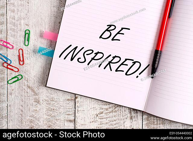Conceptual hand writing showing Be Inspired. Concept meaning fill someone with urge or ability to do or feel something Notebook stationary placed above classic...