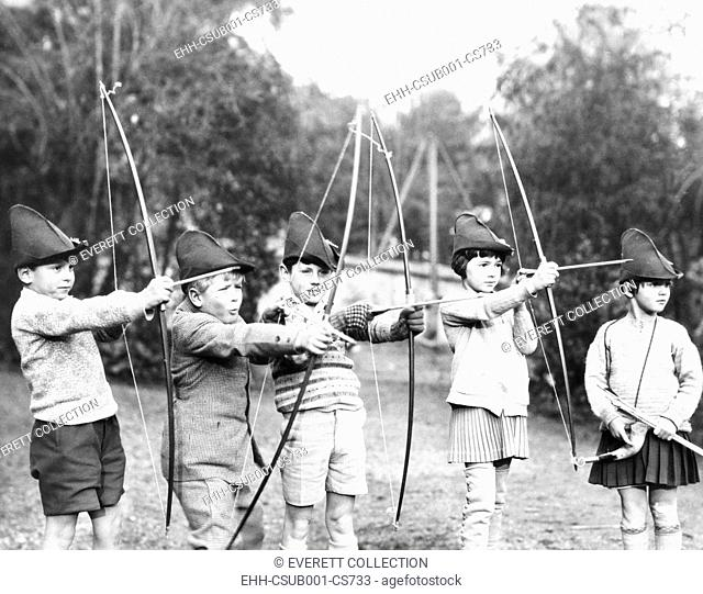 Britain's Prince Philip, (2nd from left) at an American school at St. Cloud, France. Ca. 1931. In an archery class, L-R: Jacques de Bourbon; Phillip; Teddy...
