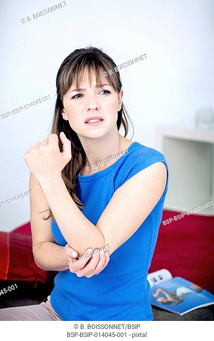 Elbow pain in a woman
