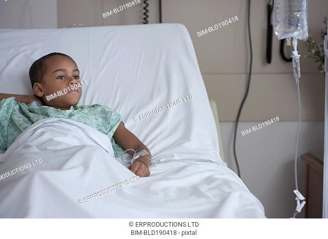 Mixed Race boy in hospital bed