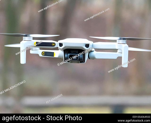 Quadrocopter in flight in the air. Dron.Technology. Place for text. Background image