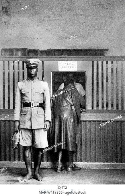 africa, liberia, policeman guarding a post office, 1930-40