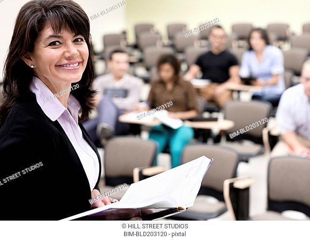 Caucasian teacher reading to classroom