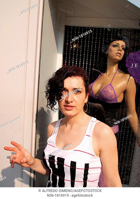 woman next to shopwindow