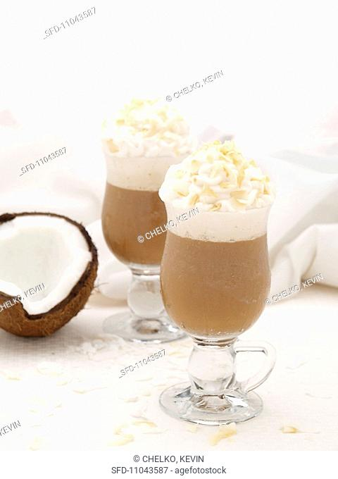 Two Lattes with Whipped Cream and Toasted Coconut in Glass Mugs