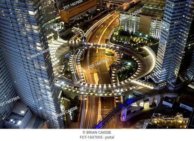 High angle view of illuminated highway amidst city buildings at night, Las Vegas, Nevada, USA